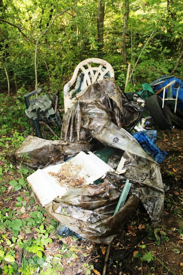 chairs, canvas and other litter from the pond